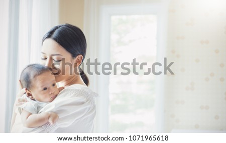 Close up portrait of beautiful young asian mother kissing her newborn baby in hospital. Healthcare and medical love asia woman lifestyle mother's day concept with copy space.  #1071965618