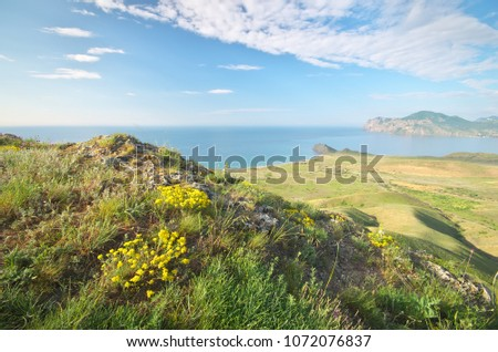 Sea and mountaing spring bay. Nature landscape composition. #1072076837