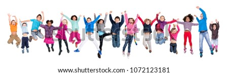 Large group of happy kids jumping isolated in white #1072123181