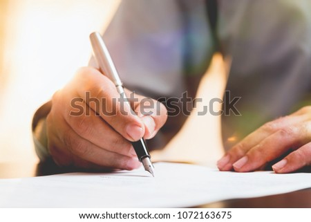 Businessman Signing An Official Document #1072163675