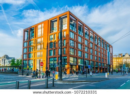 MANCHESTER, UNITED KINGDOM, APRIL 11, 2017: People are walking on a street in Manchester, England #1072210331
