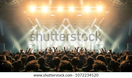 Concert wide arena with happy fans clapping #1072234520
