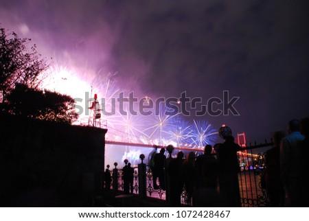 Fireworks on Bosphorus Bridge at night Istanbul, Turkey #1072428467