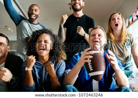 Friends cheering sport league together #1072463246