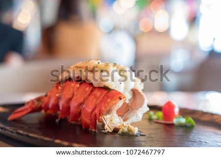 Grilled Lobster and vegetables on plate. #1072467797