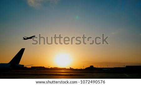 Plane taking off sky sunset sun dusk in airport China. #1072490576