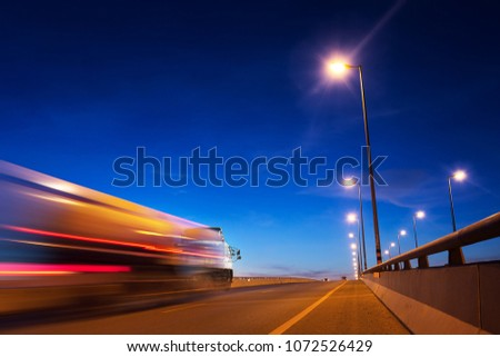 Speed motion of truck with light trails ,long shutter speed exposure.