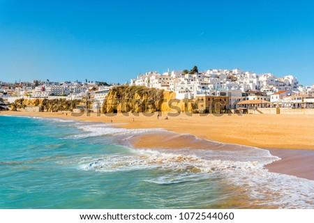 Wide sandy beach in white city of Albufeira, Algarve, Portugal #1072544060