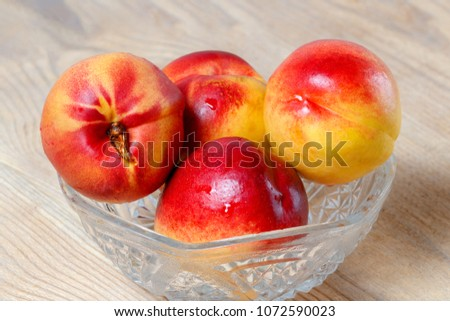 Group of ripe juicy nectarines close-up. #1072590023