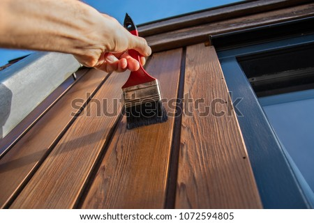 Painting woodwork outside #1072594805