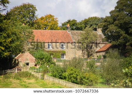 BEAMISH, COUNTY DURHAM, UK - AUGUST 31, 2014: A 1940's English farm and gardens at the Beamish Living Museum near Stanley, recreating the atmosphere of life as it was in North East England. #1072667336
