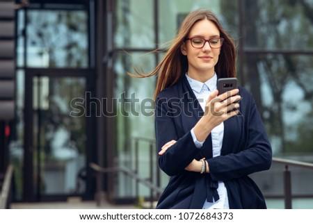 Business woman sending a message #1072684373