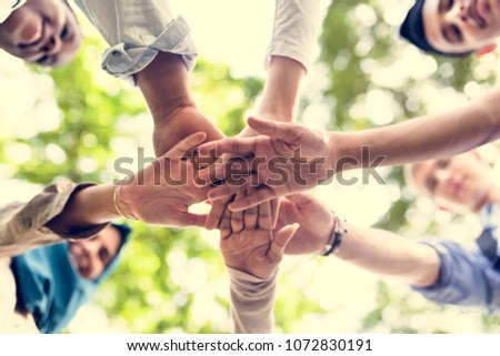Group of diverse youth with teamwork joined hands #1072830191