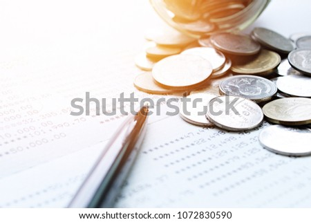 Business,  investment or accounting concept : American Dollar cash money, notebook paper, pen and savings account passbook or financial statement on office desk table #1072830590