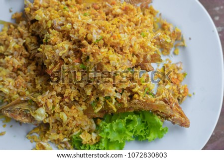 Fried Fish with Fresh Turmeric on white dish. Asia food style. #1072830803