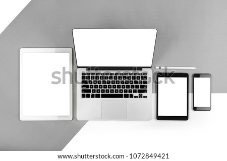 Office table with laptop computer, digital tablet, smartphone, pencil and mouse on isolated pure white background. Laptop and tablet mockup concept. (Monitor clipping path)(Selective Focus) #1072849421