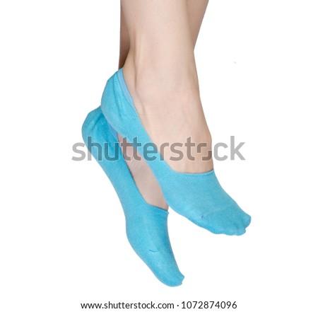 Female feet in no show socks on white background isolation #1072874096