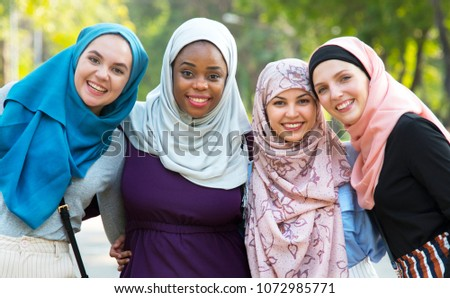 Group of islamic friends embracing and smiling together #1072985771