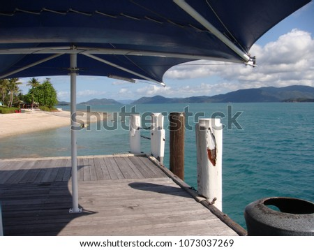 Tropical seascape from old jetty at idyllic Daydream Island, Queensland Australia #1073037269