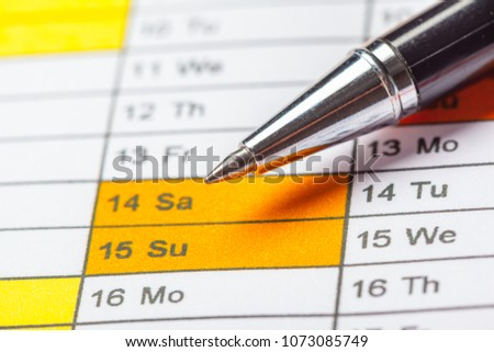Closeup of dates on calendar page #1073085749