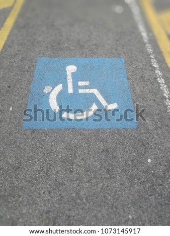 Handicapped reserved car park. Space for the disabled. Disability. #1073145917