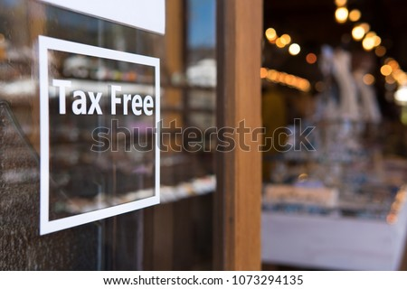 tax free sticker in front of store,tourist shopping store without tax. #1073294135