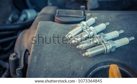 replacing spark plugs in the car Royalty-Free Stock Photo #1073364845