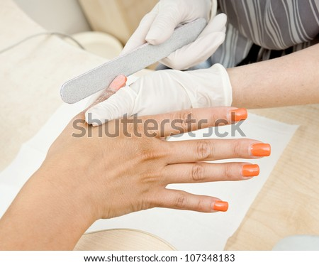 woman hand in manicure treatment detail #107348183