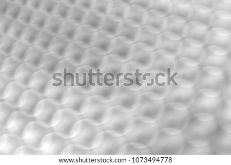 Blurred stainless steel sheet with black holes. #1073494778