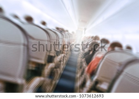 aerophobias concept. plane shakes during turbulence flying air hole. Blur image commercial plane moving fast downwards. Fear of flying. collapse slump, depression, downfall, debacle, subsidence. dive #1073612693