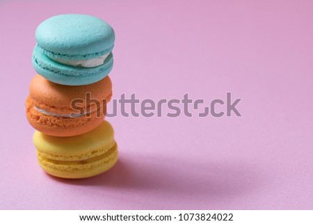 Macaron arranged on a pink background