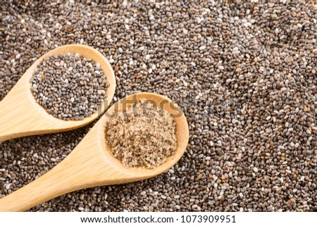 Ground chia seeds in wooden spoons - Salvia hispanica #1073909951