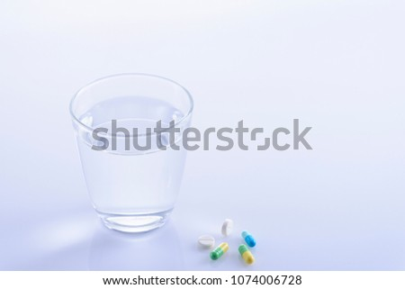 Cup and medicine #1074006728