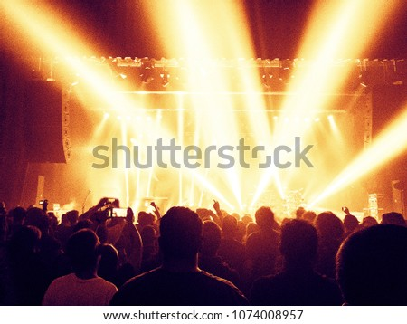 Live show musical performance with crowd silhouette #1074008957