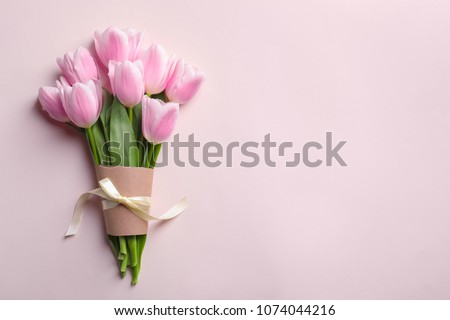 Beautiful tulips for Mother's Day on light background, top view #1074044216