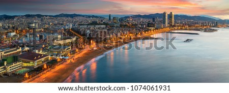 Barcelona beach on morning sunrise with Barcelobna city and sea from the roof top of Hotel, Spain #1074061931
