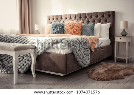 Luxury bed in hotel room #1074071576