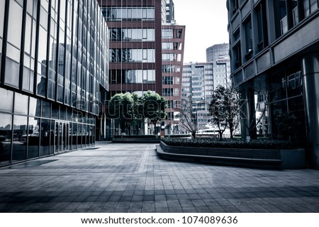 entrance of modern office building #1074089636