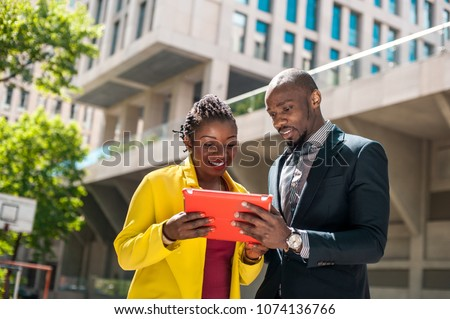 African happy people hold gadget at street urban background