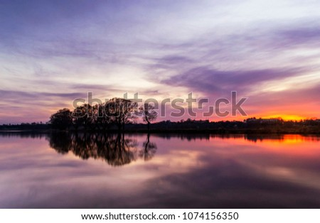 purple sky over a body of water #1074156350