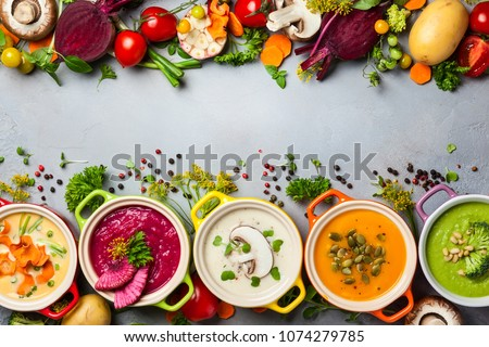 Variety of colorful vegetables cream soups and ingredients for soup. Top view. Concept of healthy eating or vegetarian food. #1074279785