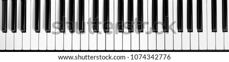 Piano keyboard. Flat top view. Horizontal photo Royalty-Free Stock Photo #1074342776
