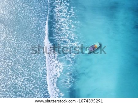 Wave and boat on the beach as a background. Beautiful natural background at the summer time from air #1074395291