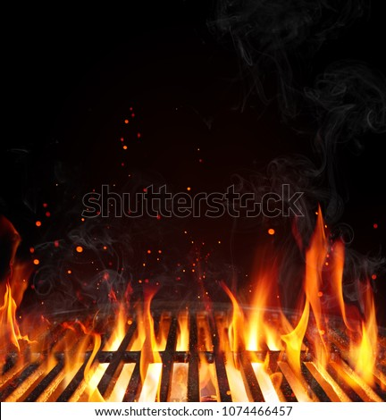 Grill Background - Empty Fired Barbecue On Black  Royalty-Free Stock Photo #1074466457