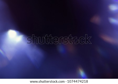 lens flare. colorful abstract blur bokeh light. dark background #1074474218