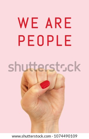 There is a female fist on a pink background and inscription We are people #1074490109