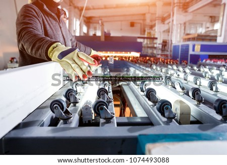 Conveyor belt for production a window pane. Industrial equipment. Background #1074493088