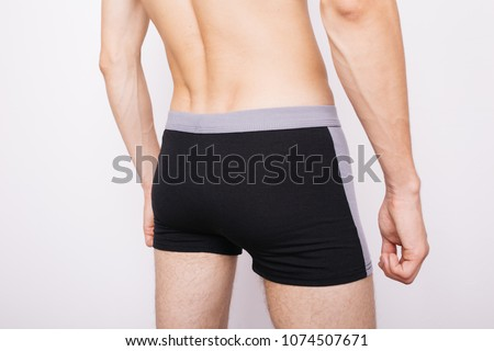 young guy in boxer shorts. underwear for men. tight ass #1074507671