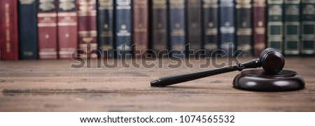Law and Justice, Legality concept, Judge Gavel on a wooden background, Law library concept. #1074565532