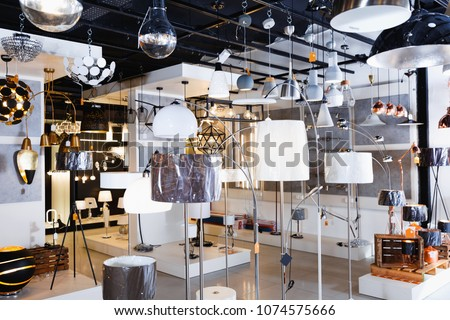 Picture of different fashionable modern beautiful stylish lamp with lights in the  designer furniture store  #1074575666